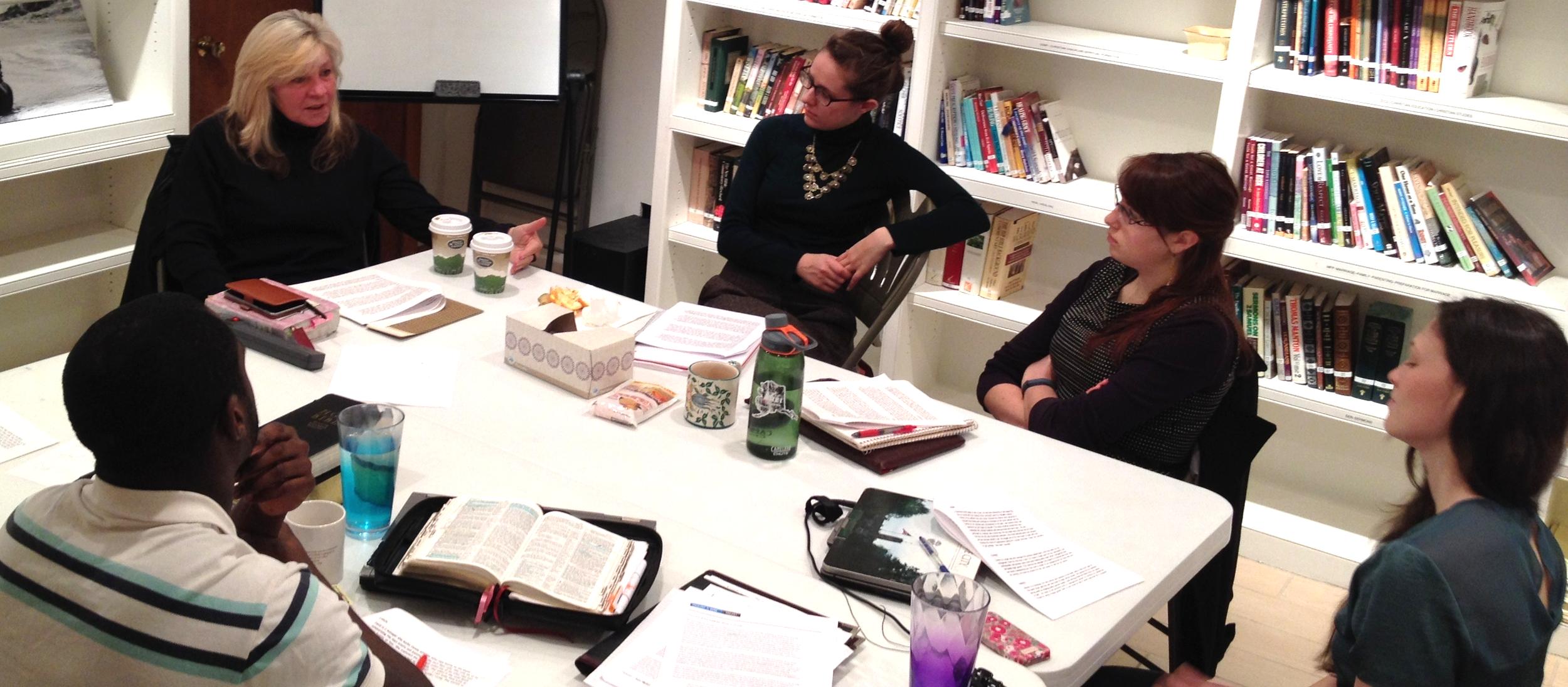 Nancy Matheson-Burns, President/CEO of Dole & Bailey, discusses case studies witha Fellows cohort.