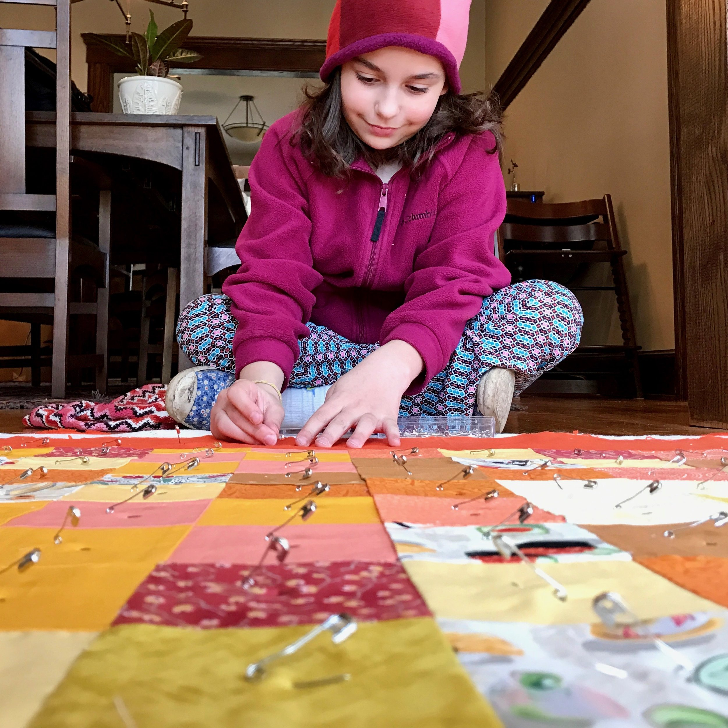 Pin basting the quilt with the help of my Girl Scout.