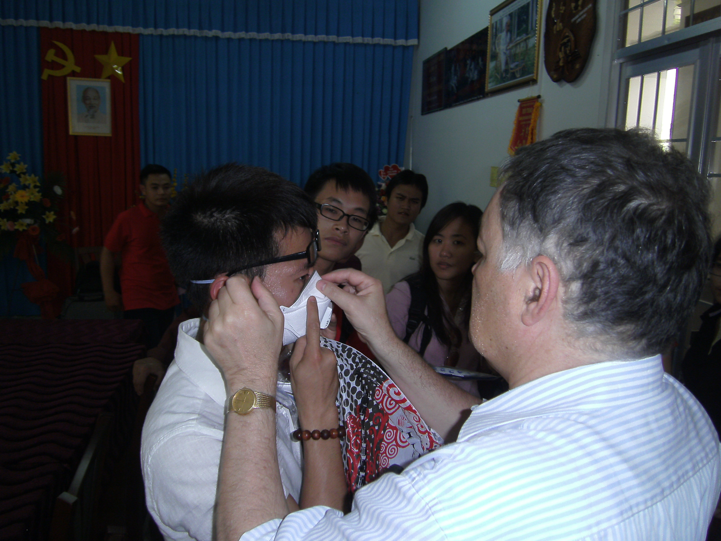 Prof Guy Marks teaching fieldstaff in Vietnam how to use Personal Protective Equipment