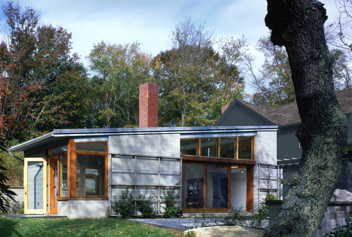 Fisher Islan House by Ryall Porter Sheridan Architects.This addition to an existing house provides the owners with a new living room and master suite connecting directly to their beloved garden. The wing is constructed of low maintenance and environmentally friendly materials: concrete block walls, concrete floors, and interior walls of compressed, recycled newsprint.