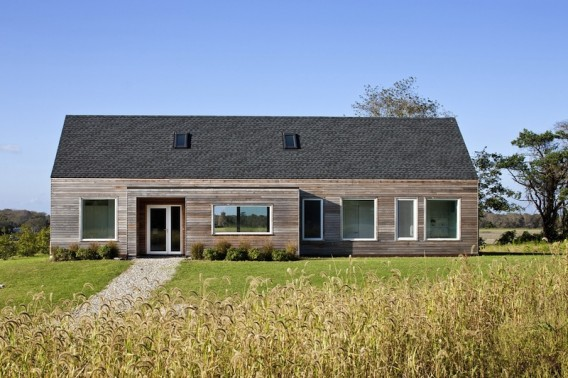 Little Compton Rhode Island by ZeroEnegy Design 2011.A sleek, simple, gable roofed structure was designed and proposed  with  the Passive House standard. A combination of exceptional insulation, air sealing, high performance windows, and solar gain reduces the space conditioning requirements to a mere fraction of a typical home, and uses only a very small heating system.
