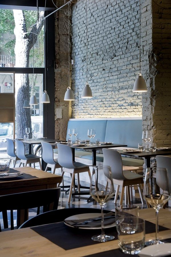 De Pasta Kantine, Rotterdam  In this restaurant interior, there is a wonderful mixture of a variety of styles and textures. Exposed brick wall, serves as a backdrop for softer lines of furnitures and accessories.
