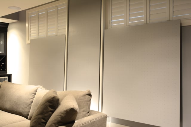 Home theatre room -  custom made sound absorbing back wall panels.