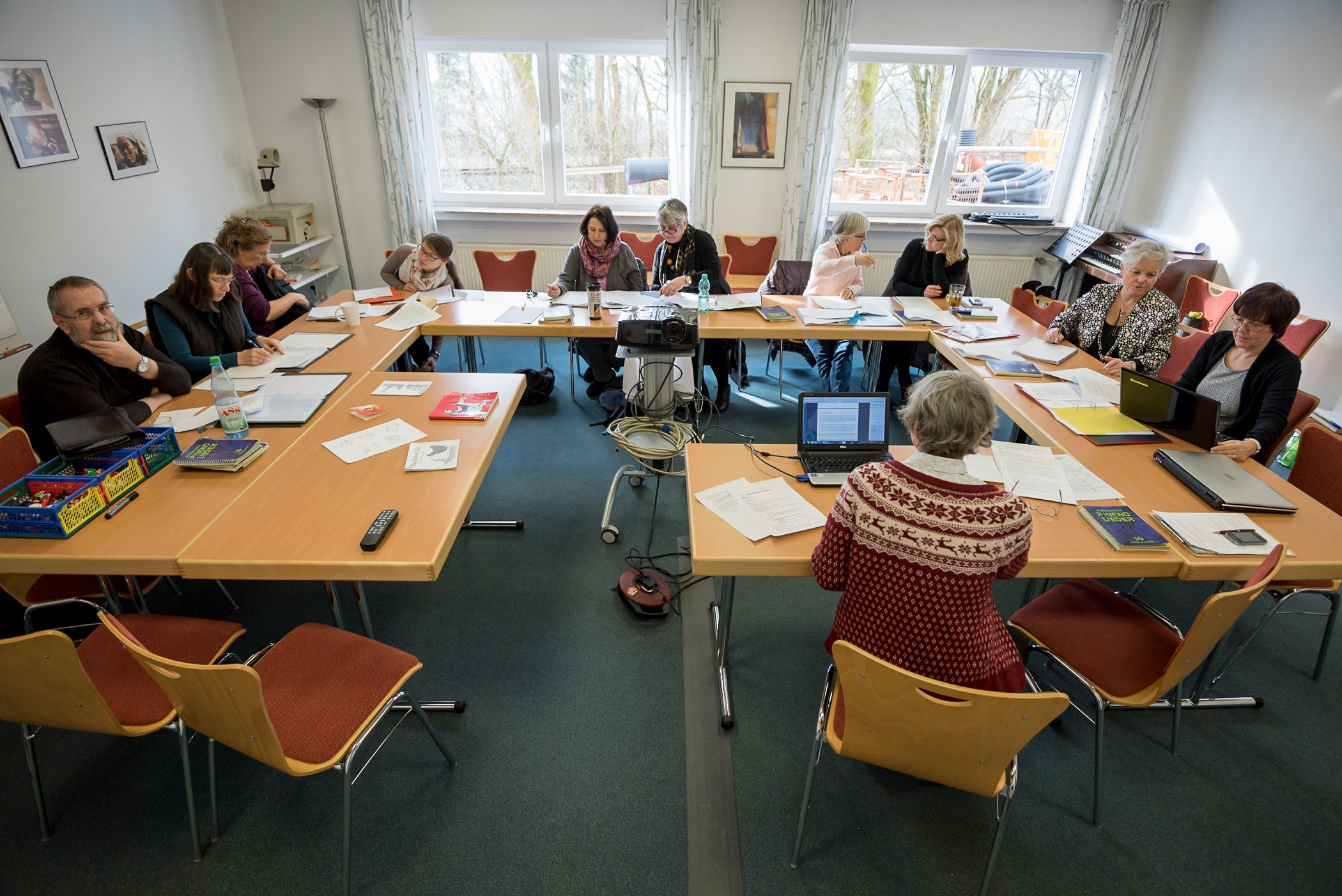 Participants in the German for Refugees course discuss the effectiveness of their sample lessons as well as additional teaching tools at the Wycliffe Germany offices in Holzhausen, Germany. The German for Refugees course is a train-the-trainer course designed to equip Germans to teach their language to recently arriving refugees.