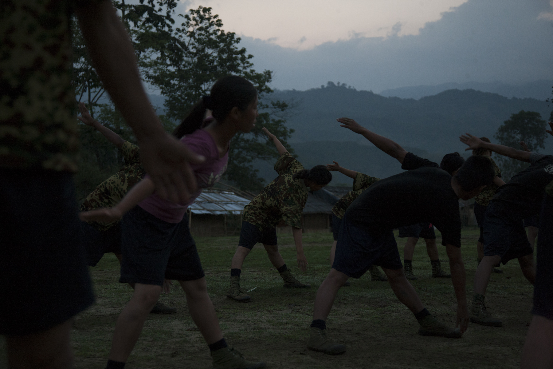 For two months basic military training began every morning before sunrise at the KIA's military base outside of Laiza, Kachin State, Myanmar, May 21, 2013.