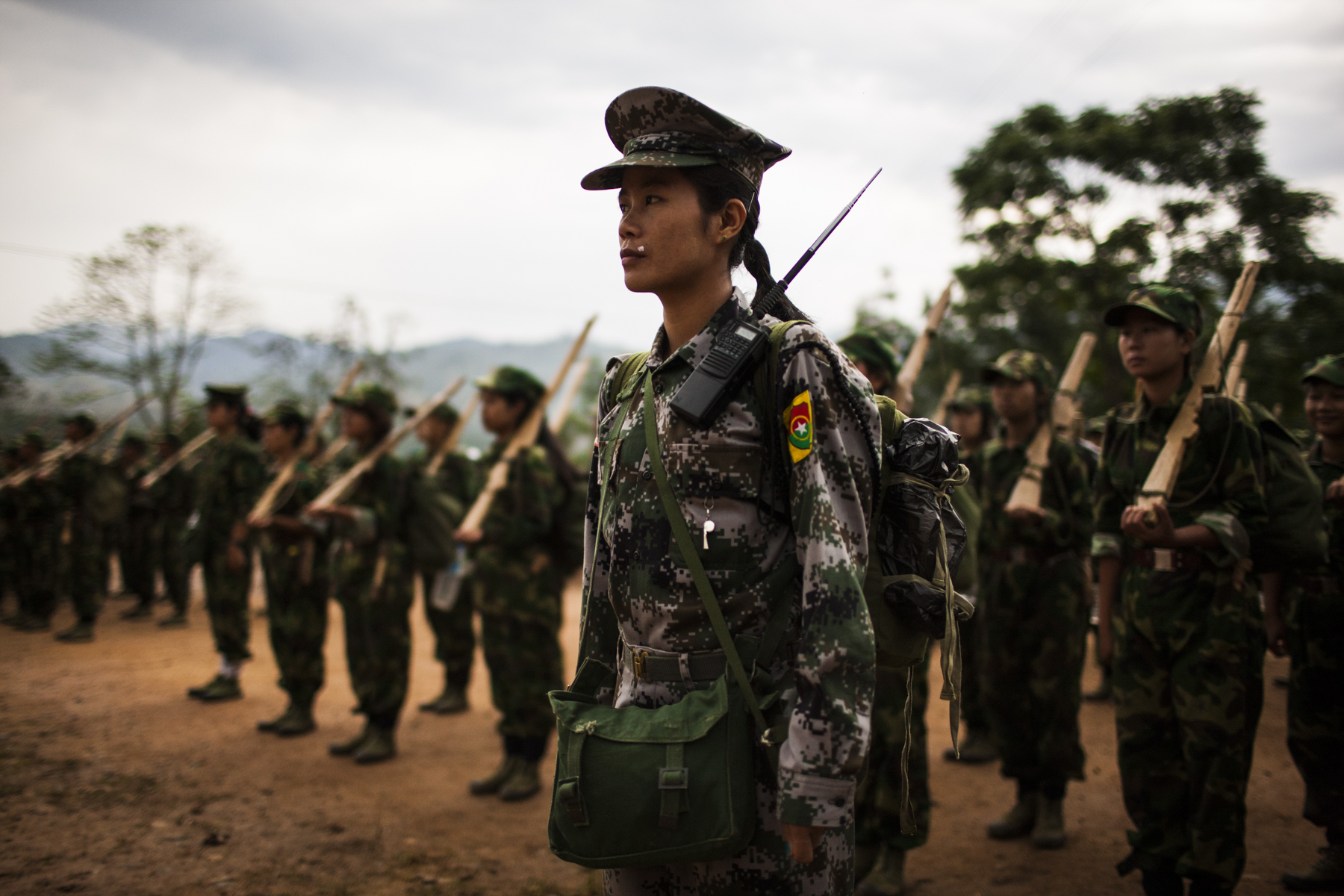A member of the KIA's Women's Armed Forces helps to lead basic military training at the army base outside of Laiza, Kachin State, Myanmar, May 13, 2013. According to UNHCR there a over 100,000 IDPs in Kachin State and northern Shan State.