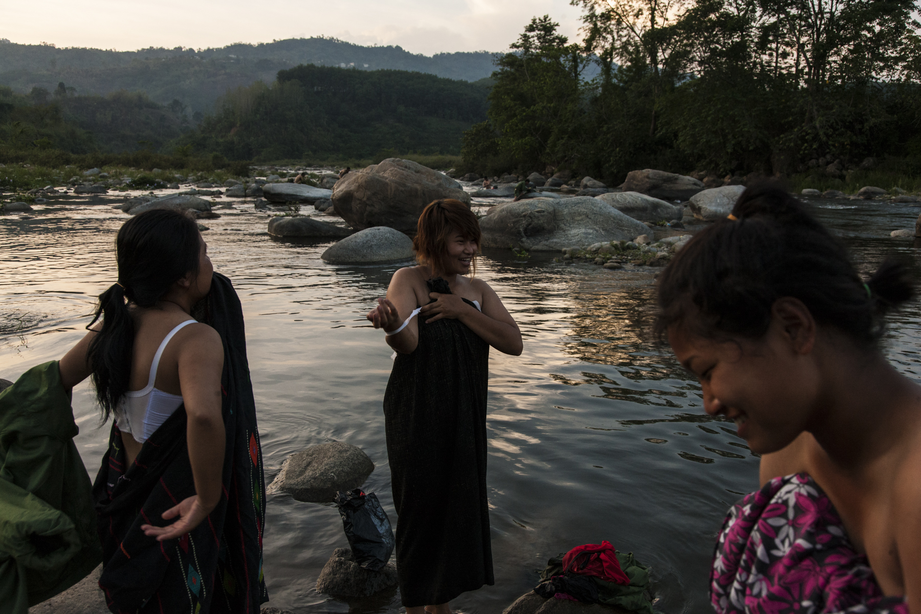 After their training the women were given 15 minutes to wash themselves and their clothes in the river near the KIA's military base outside of Laiza, Kachin State, Myanmar, May 17, 2013. They tried to cover themselves while bathing the best that they could as the men washed just upstream.