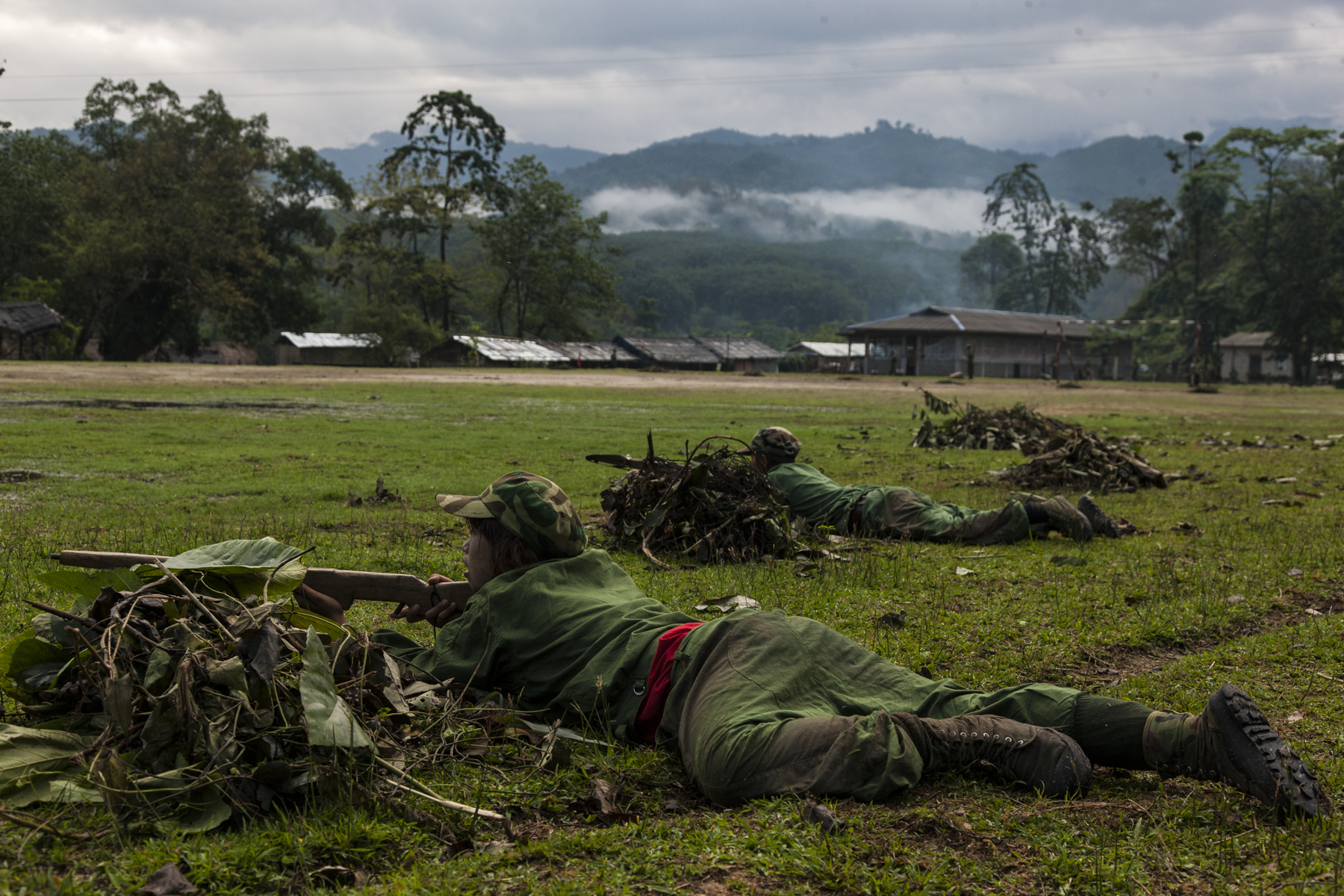 Basic military training began every morning before sunrise at the KIA's military base outside of Laiza, Kachin State, Myanmar, May 17, 2013.