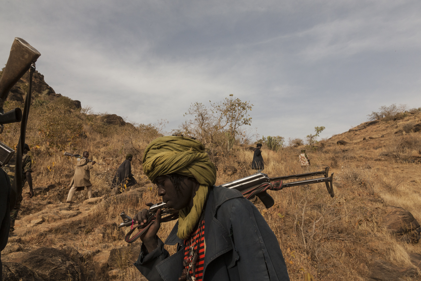 Members of the rebel group the Sudan Liberation Army led by Abdul Wahid (SLA-AW) climb towards the front lines in Jebel Marra, Central Darfur, Sudan, March 4, 2015.