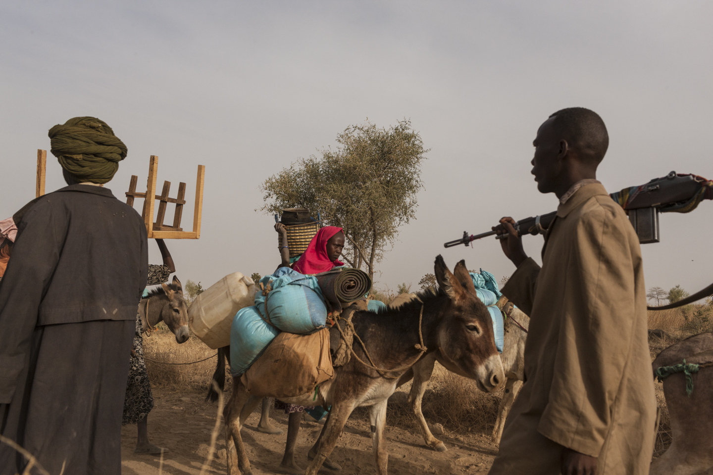 Civilians flee their homes with the few belongings that they can carry, while the SLA-AW walks towards the front lines in Central Darfur, Sudan, March 4, 2015.