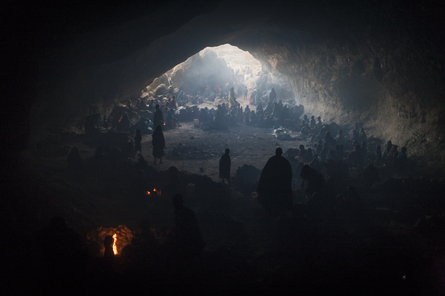 Hundreds of women and children seek shelter in a cave from the bombing by the Sudanese government's forces outside of the town of Sarong in Central Darfur, Sudan, March 2, 2015.