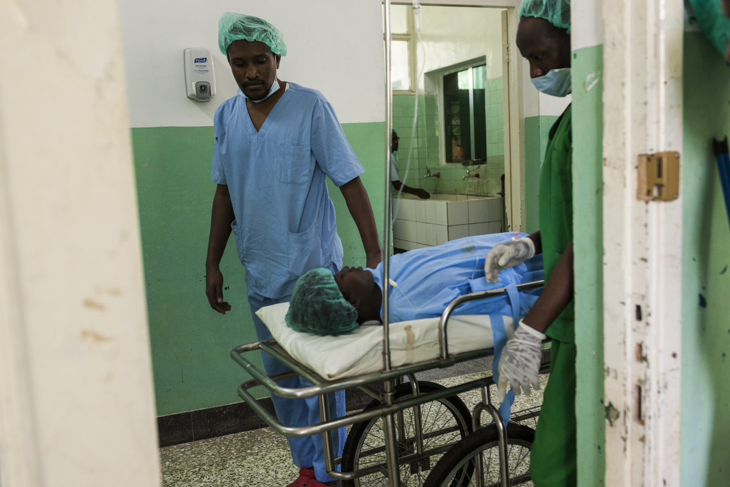 Howa Oofay Moalim, is wheeled out of her surgery after being in labor for five days with her first child who was being born in shoulder presentation. Howa had an emergency Caesarian section and both mother and baby boy are recovering in the Banadir Hospital in Mogadishu, Somalia, December 2, 2014.