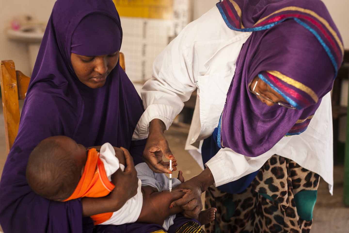 EPI Officer Saynab Saleeban immunizes Mahad, 3 months, at the Central Burao Maternal and Child Health Center in Somaliland, November 12, 2014.