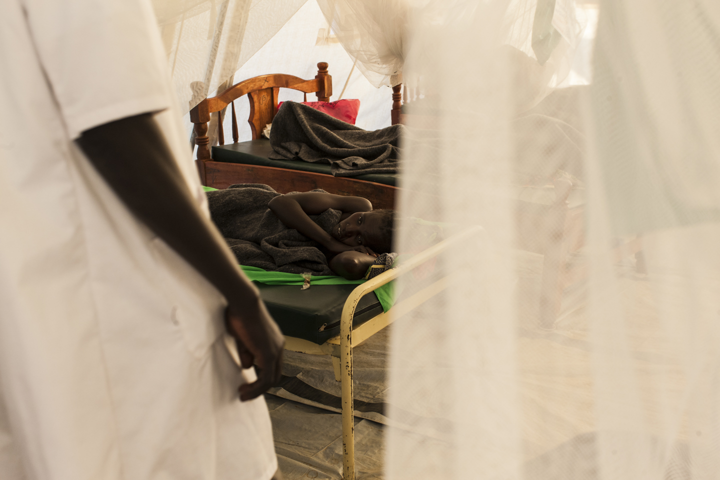 A nurse makes his rounds as women recover from their fistula surgeries at the Gogrial Health Care Center, which is run by Médecins Sans Frontières (MSF) in Gogrial, South Sudan, November 28, 2012.