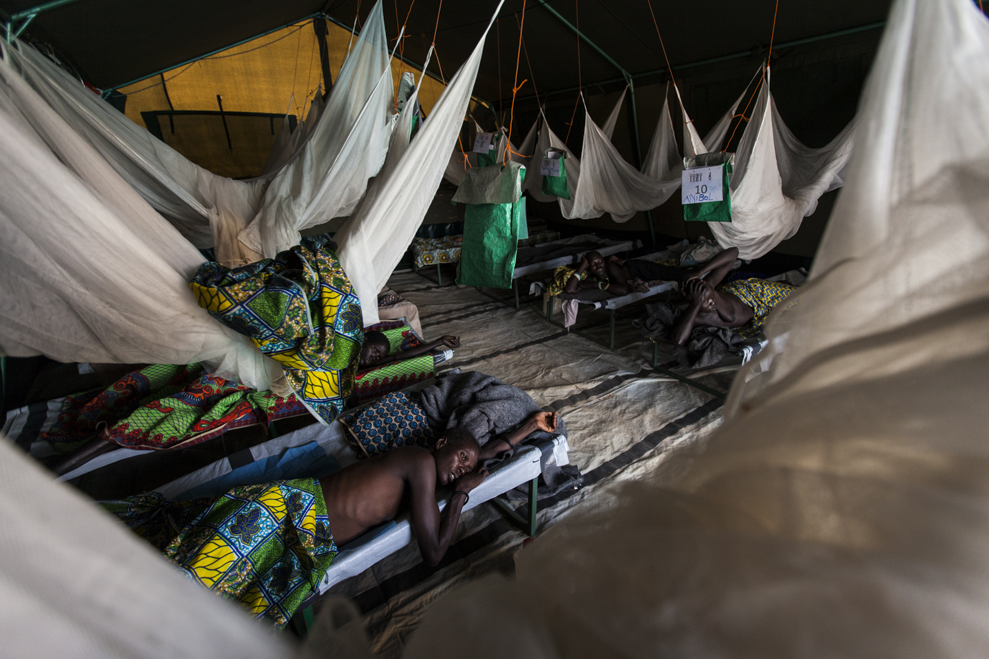 Women recover from their surgeries in the fistula village at the Gogrial Health Care Center, which is run by Médecins Sans Frontières (MSF) in Gogrial, South Sudan, November 27, 2012.