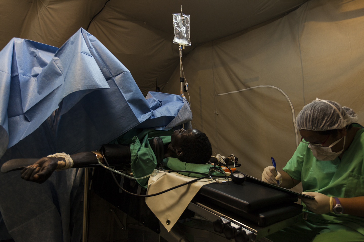 Anesthesiologist Margarita Quilala, monitors Elizabeth Aluel Piol, during surgery to repair her prolapsed uterus at the Gogrial Health Care Center, which is run by Médecins Sans Frontières (MSF) in Gogrial, South Sudan, November 26, 2012.