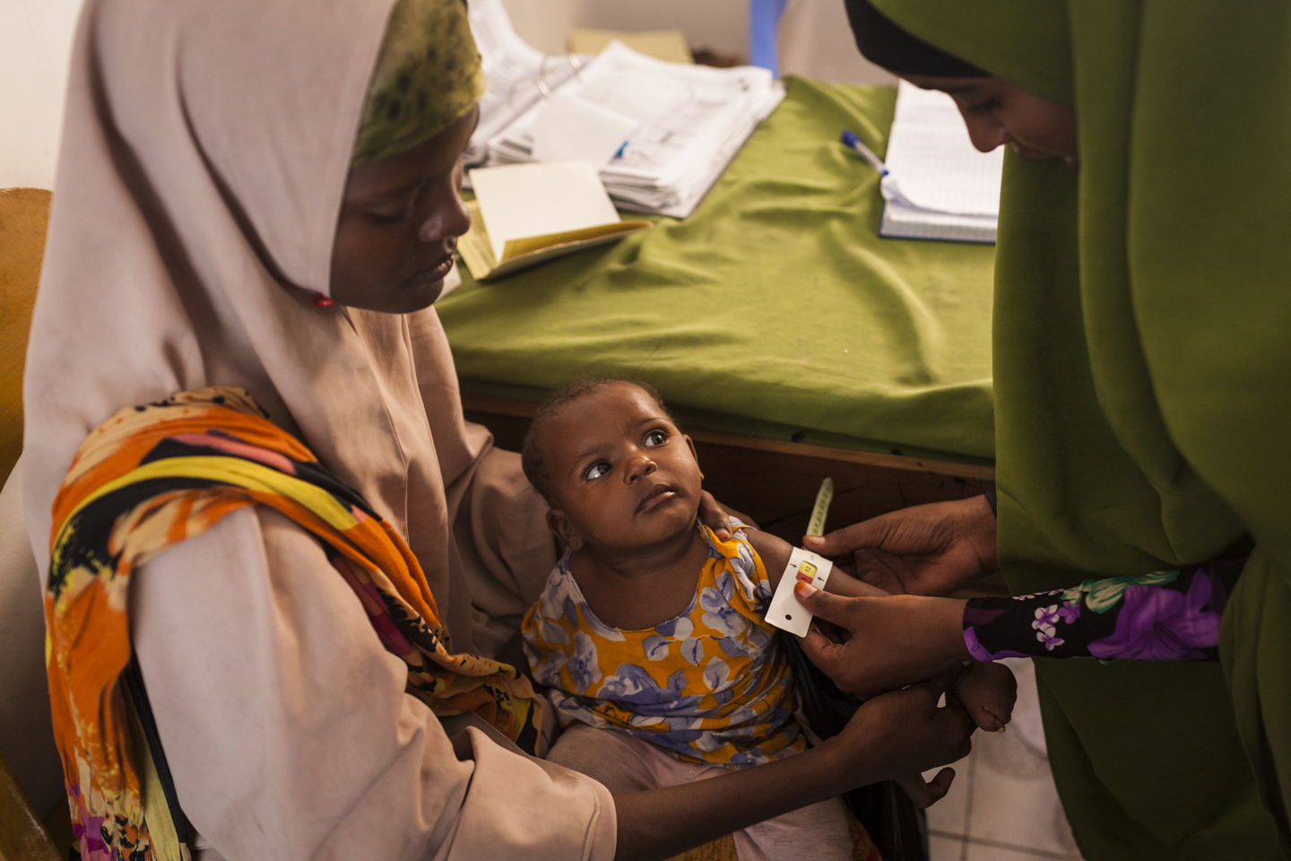 Shukri, 8 months, has her weight monitored as part of the nutrition program at the Wardhigley Maternal and Child Health Center in Mogadishu, Somalia, December 3, 2014.