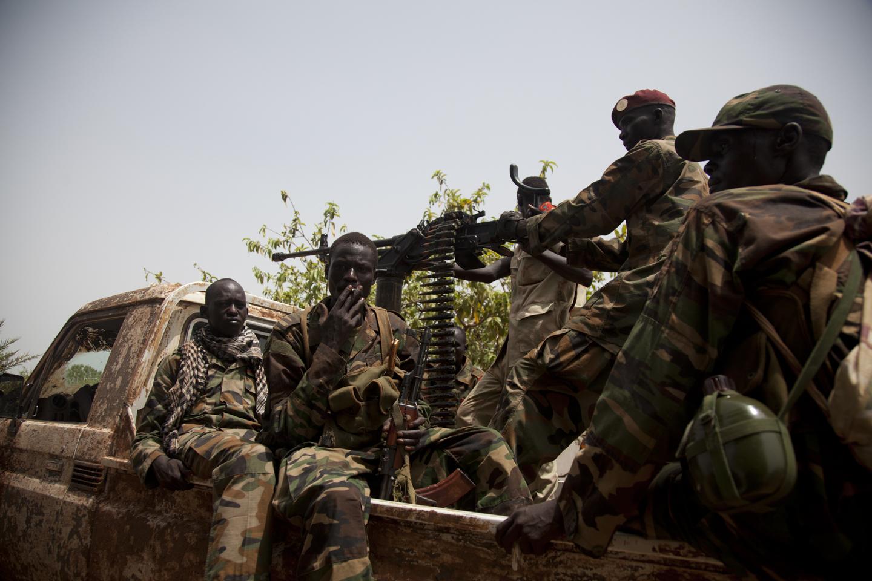 SPLA soldiers leave the Rubkona Military Hospital in Rubkona, South Sudan, April 20th, 2012.