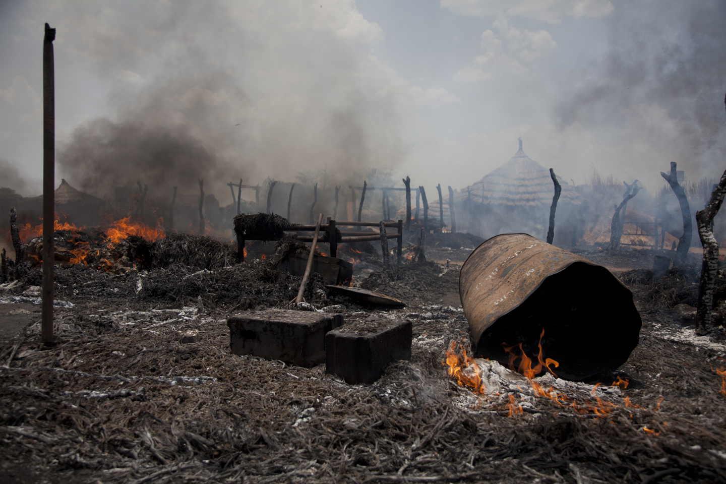Houses went up in flames after being hit by a bomb in Bentiu, South Sudan, on April 14th, 2012. The Sudan Armed Forces (SAF) dropped six bombs on the edge of Bentiu, killing four civilians and one SPLA soldier.