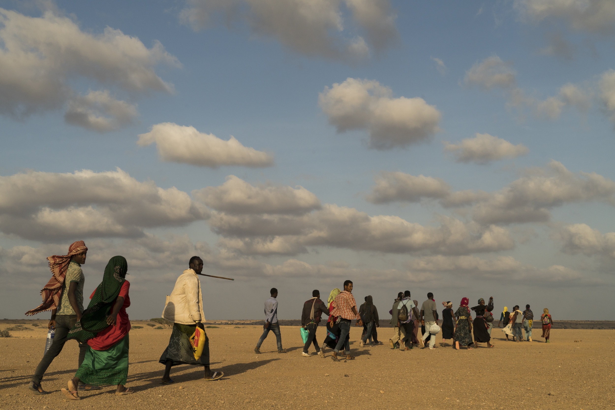 A group of young Ethiopian migrants walk through the desert on the last part of their journey before crossing by boat to Yemen from Obock, Djibouti, January 12, 2016.