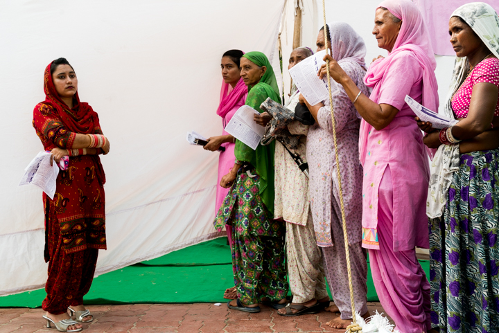 Women wait to be screened for breast cancer in Tarn Taran, Punjab, India, September 21, 2016.