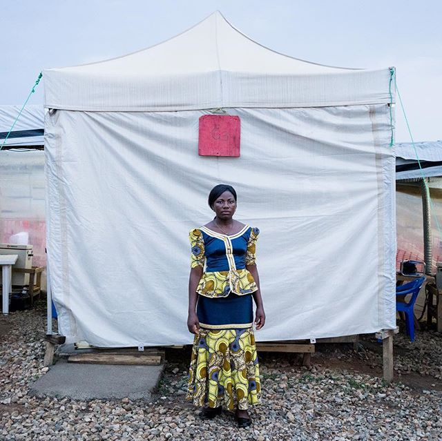 A couple both survived Ebola, and now they care for the sick - Esperance, age 25, and her husband Maurice, age 35, stand for a portrait outside of CUBE 3 and CUBE 4 where they survived and recovered from Ebola at the ALIMA Treatment Center in Beni, Democratic Republic of Congo. #onassignment @wsj @wsjphotos Text by @jcsteers #photographer #health #woman #man #doctor #photojournalism #photography #photo #portrait #portraitphotography #photo #congo #africa #adrianeohanesian