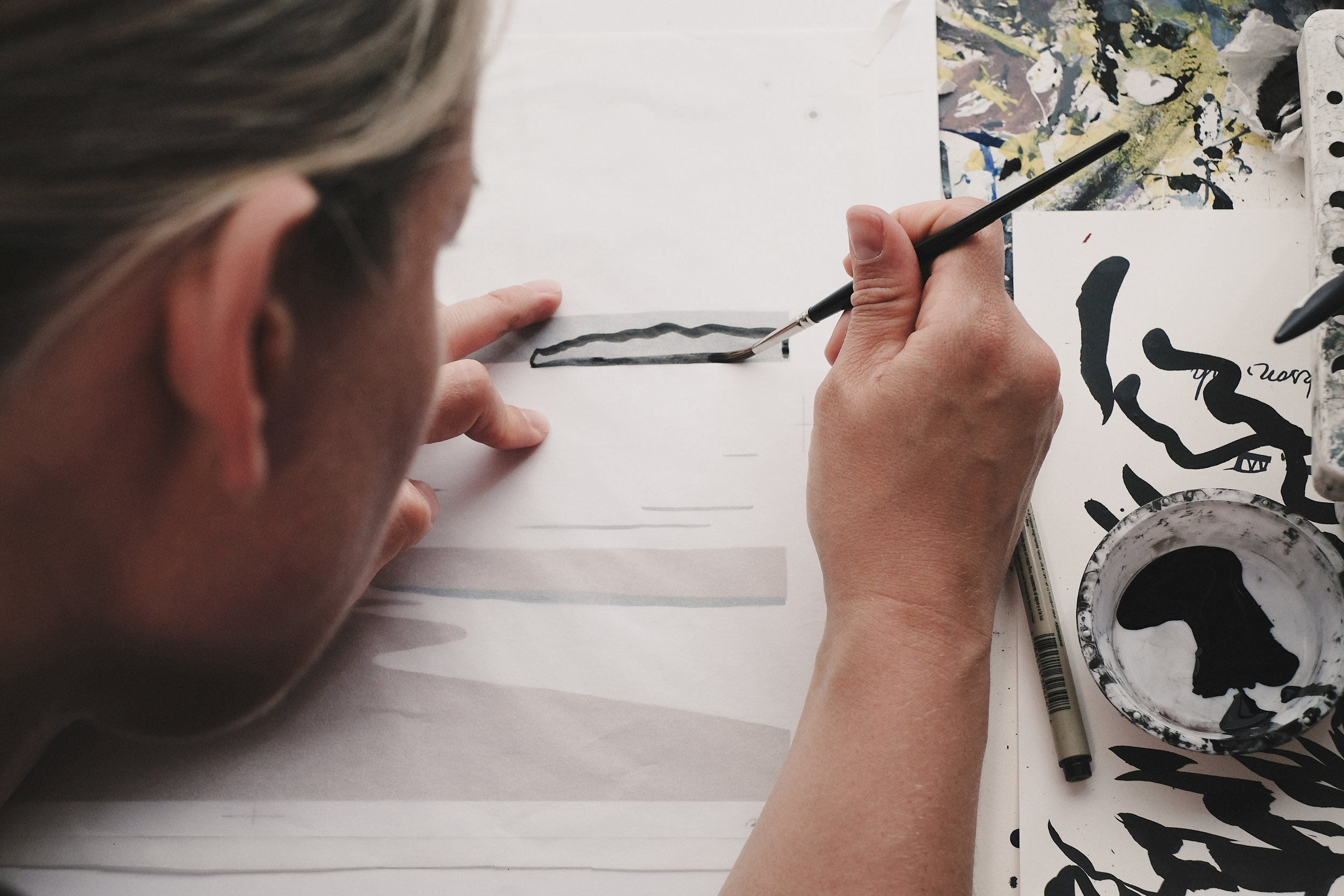 We draw all of our designs with ink -
