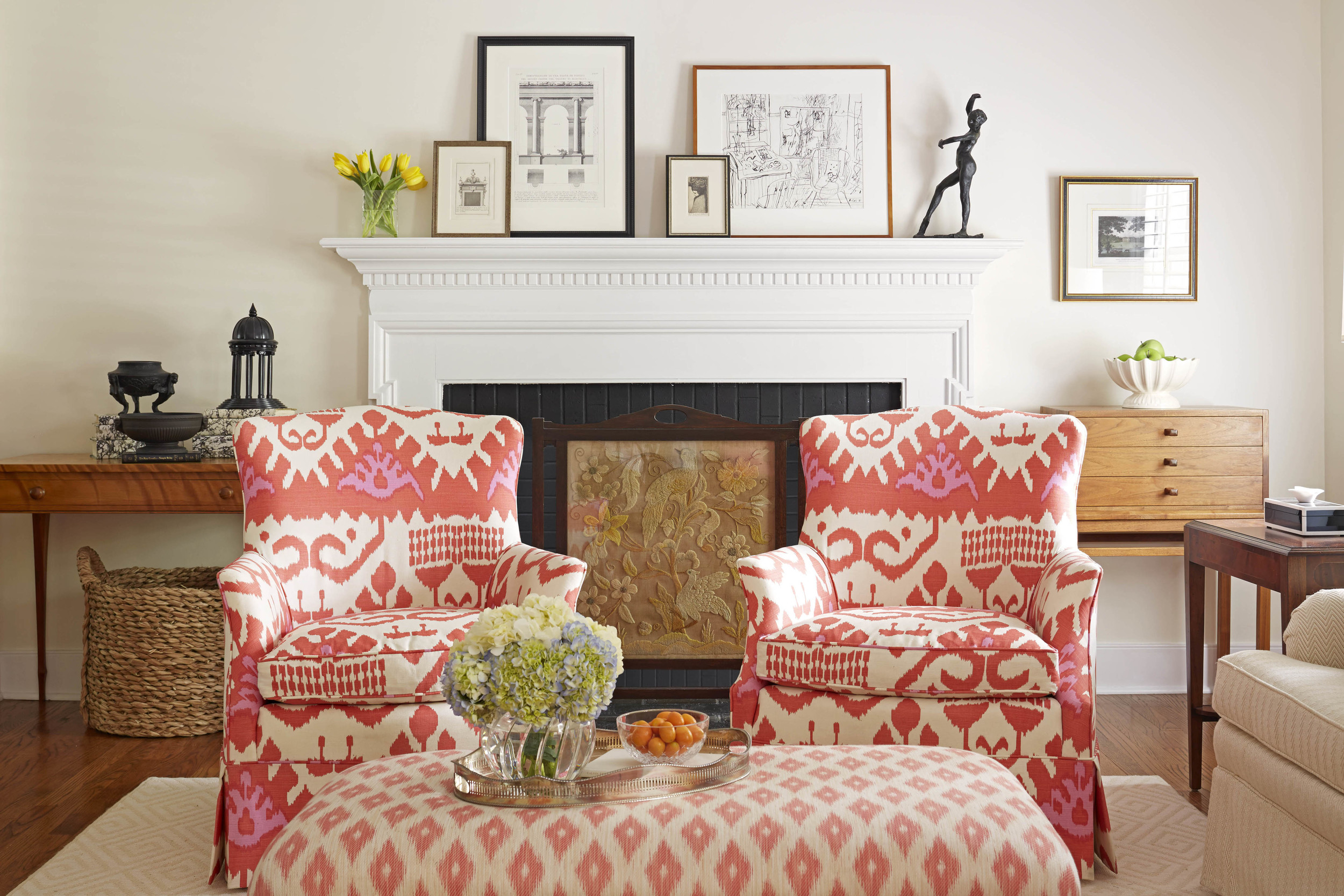"""Quadrille made the exuberant Ikat on the pair of chairs. The fireplace screen is one I found in England several years ago. The collections are asymmetrically arranged and include Wedgewood """"Basalt"""" which works equally well in traditional and modern interiors."""