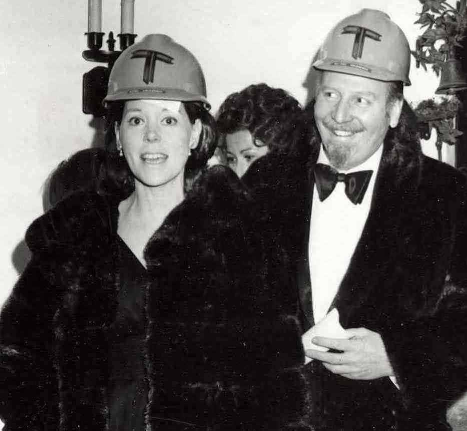 Even a concussion does not stop the party! Shown here in a humorous moment with her dear friend, Skitch Henderson, conductor of the New York Pops. Both are sporting Tishman hardhats for a company sponsored event.