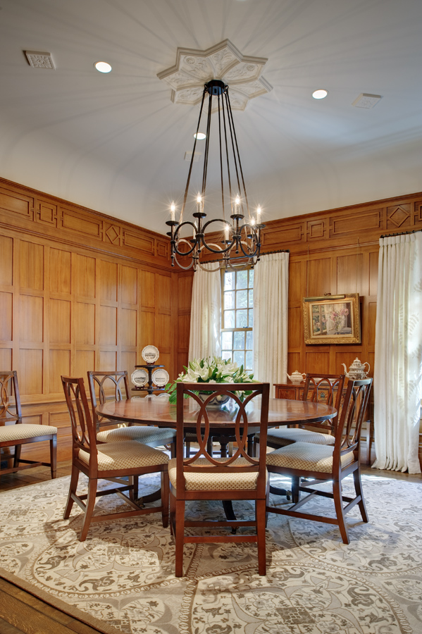 This dining room became the cypress room for clients who also owned a house in the low country of south Carolina. the fret work design is from a 16th century English house. The rug is by Stark Carpets, the chandelier is by Ironwork International. Colfax & Fowler is at the windows and completes the look.