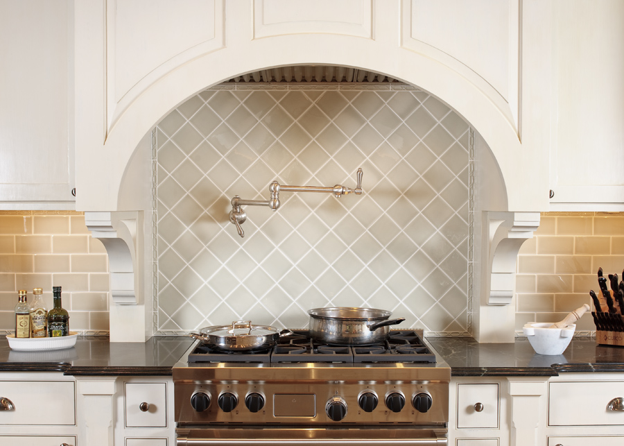 Simplicity can be beautiful. Ann Sachs tile, Wolf stove and simple cabinetry......note the bead edge frame, brackets, and aged nickel hardware.
