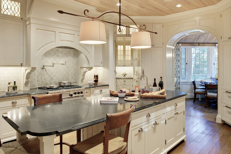 This remains one of my favorite kitchen designs. Art glass transom, Vaughan lighting fixture, adjoining butler's pantry. Ceiling is reclaimed old growth limed oak.