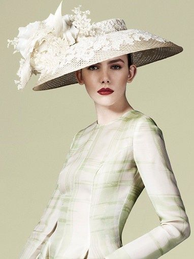 A hat fit for a Queen! Philip Treacy is a favorite of the Royal Family. This confection is beyond words.