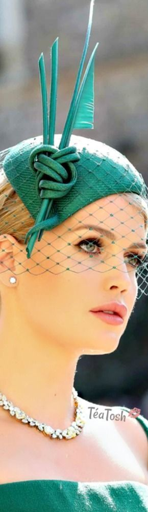 If this beautiful woman seems familiar, its with good reason, she is Lady Kitty Spencer, Diana's niece wearing a Philip Treacy original design.