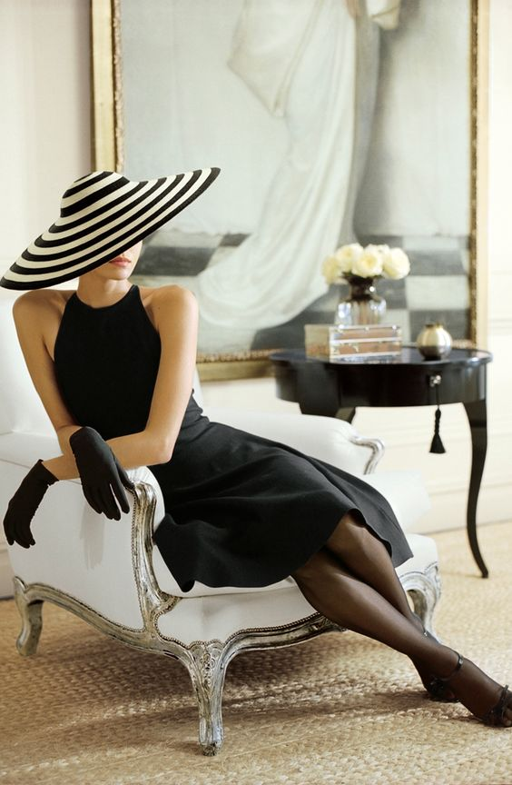 Ralph Lauren always conjures a story, a sense of drama that adds to the richness of life. Here a black and white stripe hat that captures and holds the eye.