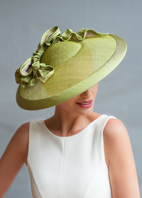 Perfect for your spring garden parties. This apple green straw hat is by Guy Morse-Brown.