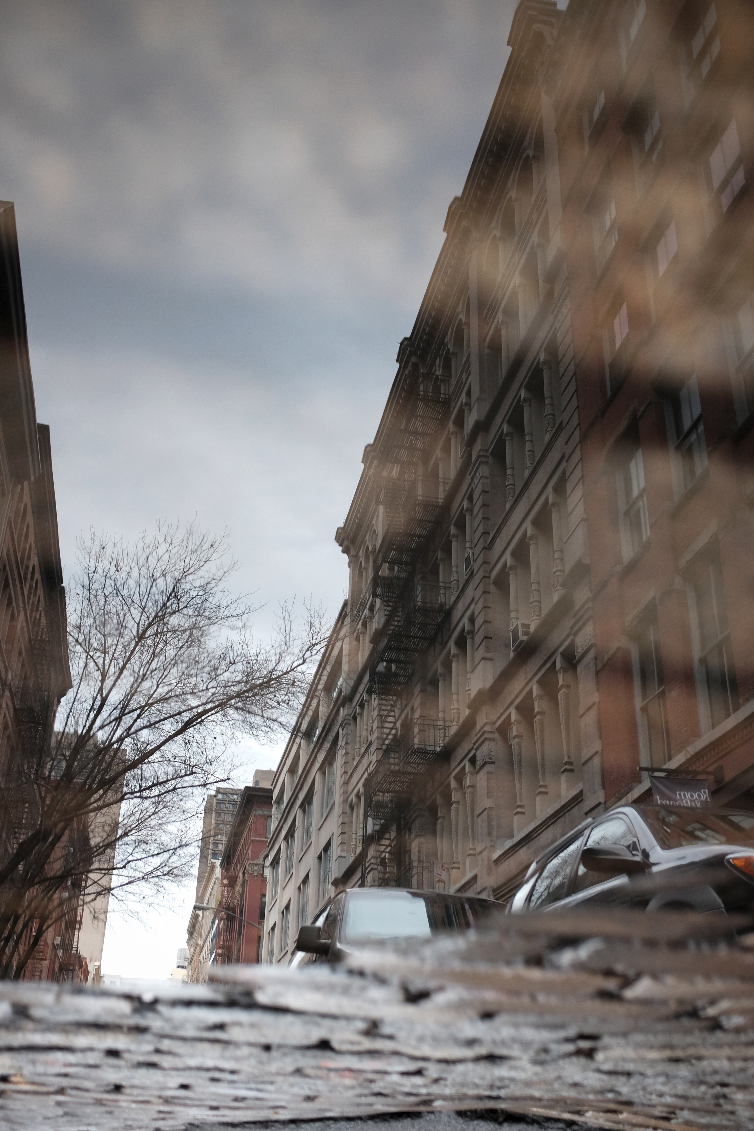 Cobblestone skies in SoHo. Just helps to make me see differently.... think differently.