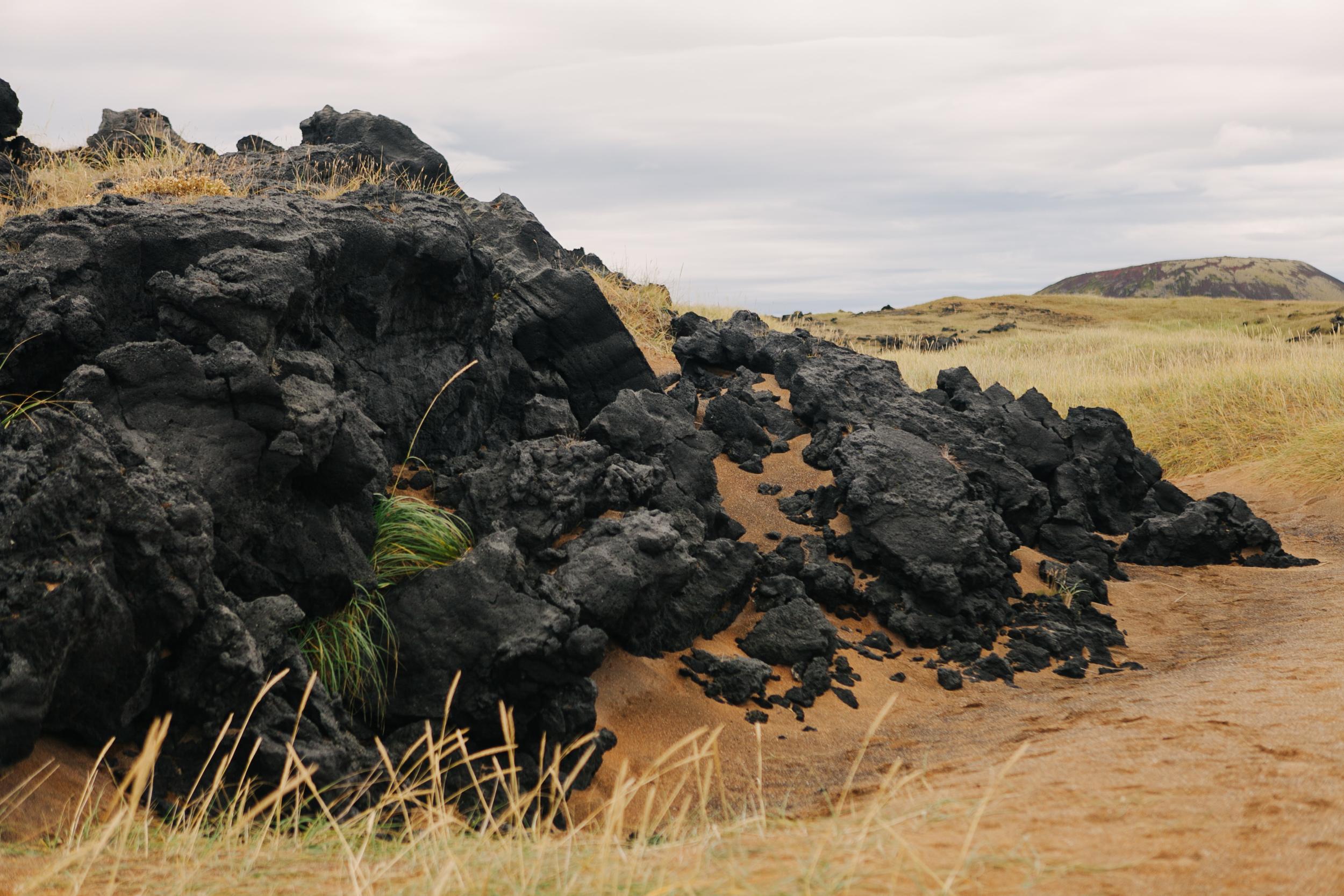 Black Lava rocks near the church