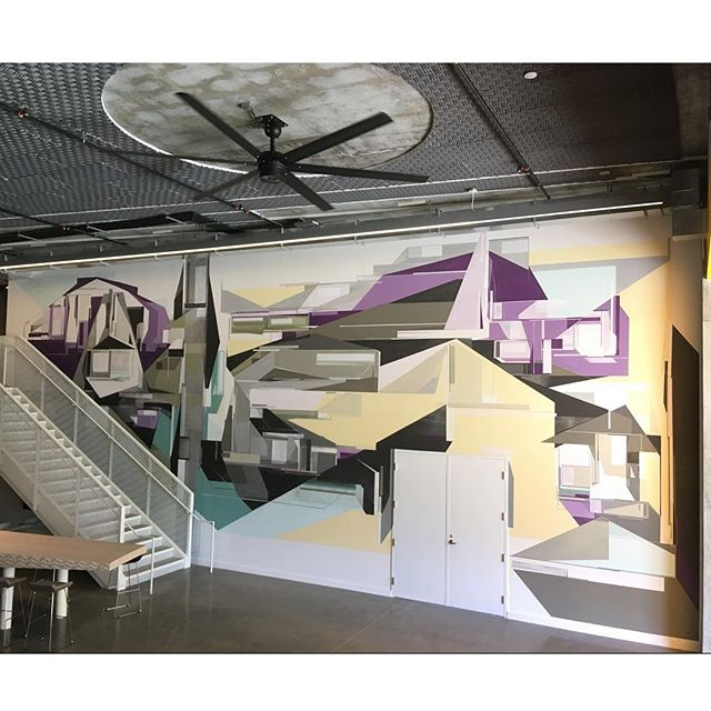 Workflow, [Completed in September, 2017]  Acrylic polymer on drywall and exposed cement.  Interior lobby ofthe C3 creative space campus designed by @gensler_design 5800 Bristol Parkway, Culver city, CA. Commissioned by IDS realty. __________________________________________________  I created this mural installation in dialogue with the staircase, so that both  mural and staircase became seamless parts of the building's whole. I played off of  the staircase's ascending steps and the 37° angle of its rails, creating diamond- like reactions that crisscross and traverse the space.  Fractals bounce off their  respective shapes, like ideas in a think tank, manifesting the ethic of worksflow:  a harmony of orchestrated and repeated systems of business activity.  The rhythmic  interlocution of shapes and patterns represents trajectory, technology and  expansion, a visual manifestation of creative collaborations to come.  __________________________________________________ #culvercitycreative #siliconbeach #interlocution #idsrealestategroup#gensler #vintagefuturism  #builtpaintings  #geometric #abstractart #abstracción #nonobjective #californiaart #muralinstallation #westcoastart