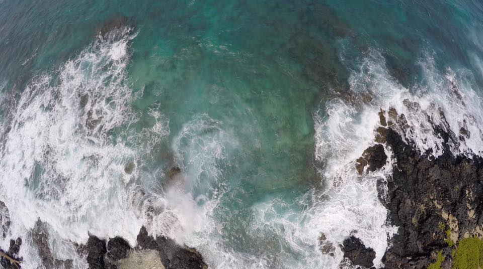 This photo has some pretty severe fisheye distortion of the waves and coastline. It was shot on a Hero 4 from a drone just outside Honolulu, Hawaii