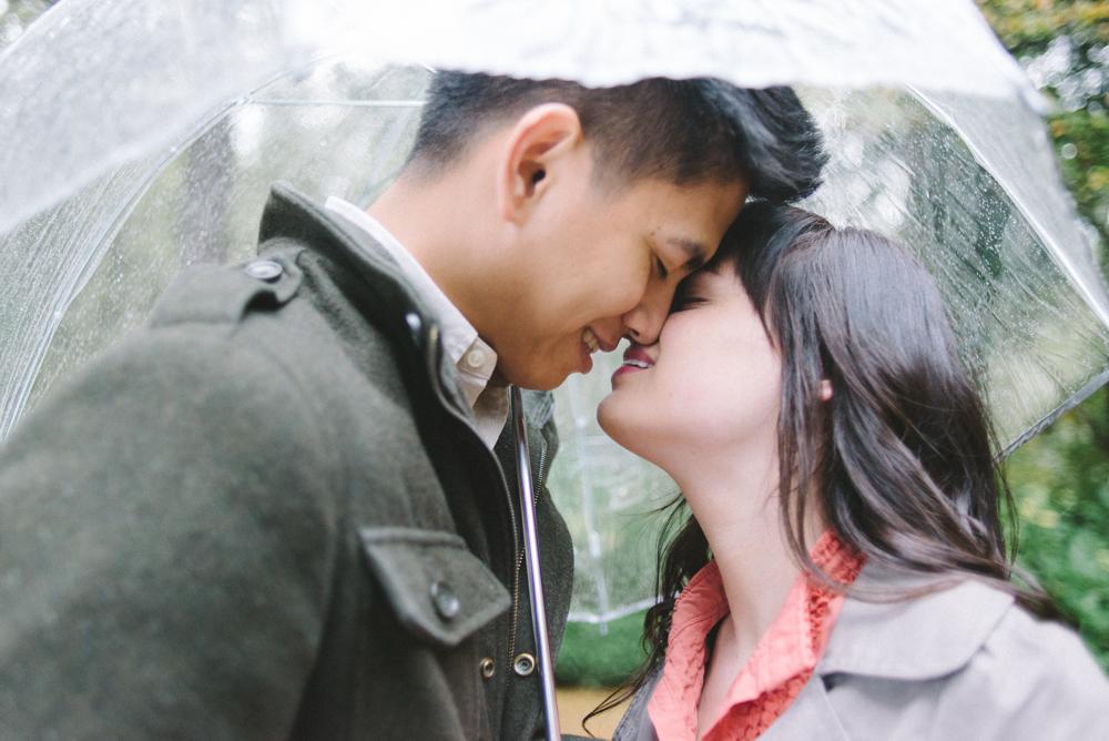 Leach-Botanical-Gardens-Engagement-Photography-umbrella-rain-kissing-Johan-Dani_0297.jpg