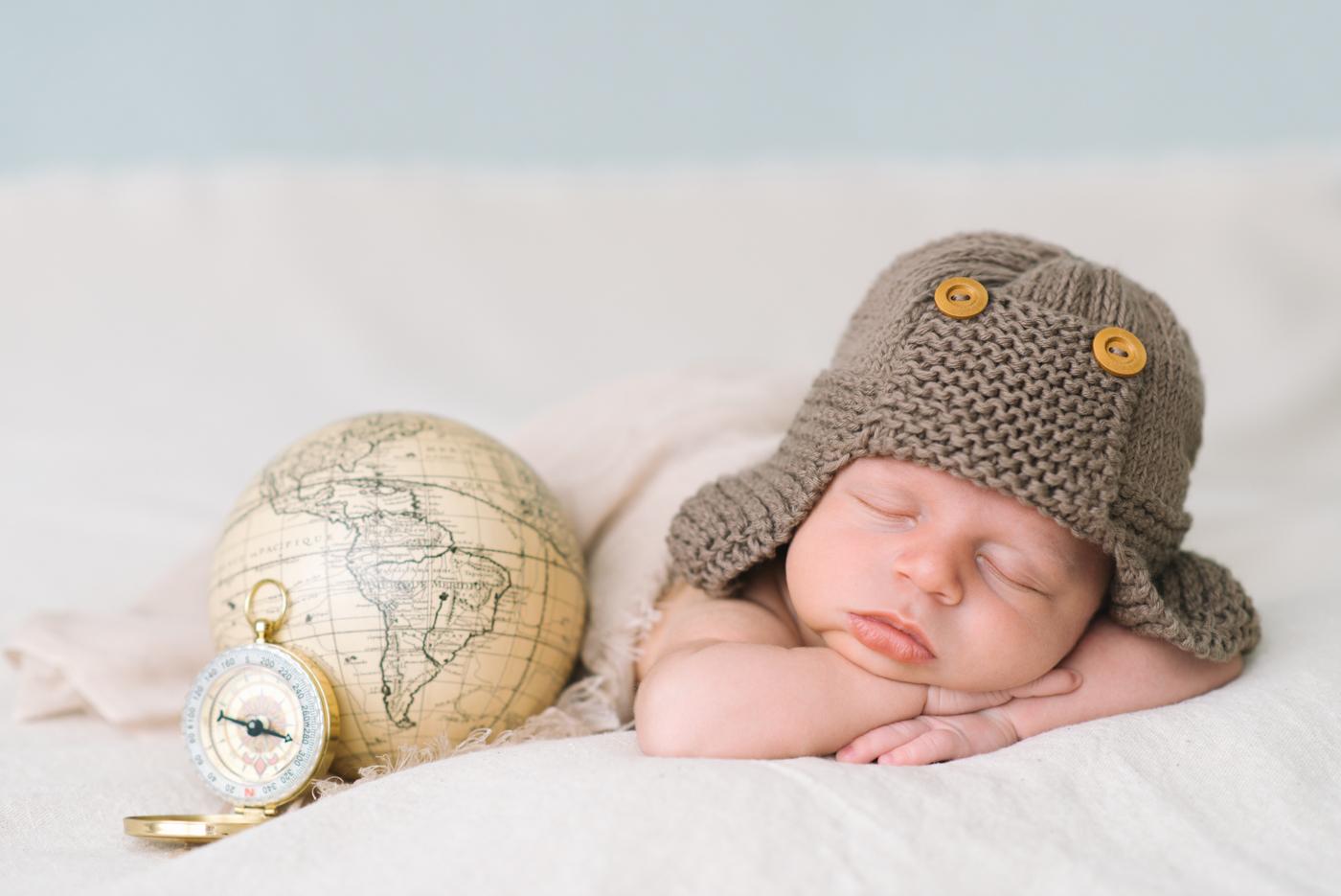 portland-oregon-newborn-photography-nautical-aviator-knit-hat-globe-compass-cute-baby-sleeping-shelley-marie-photo-1