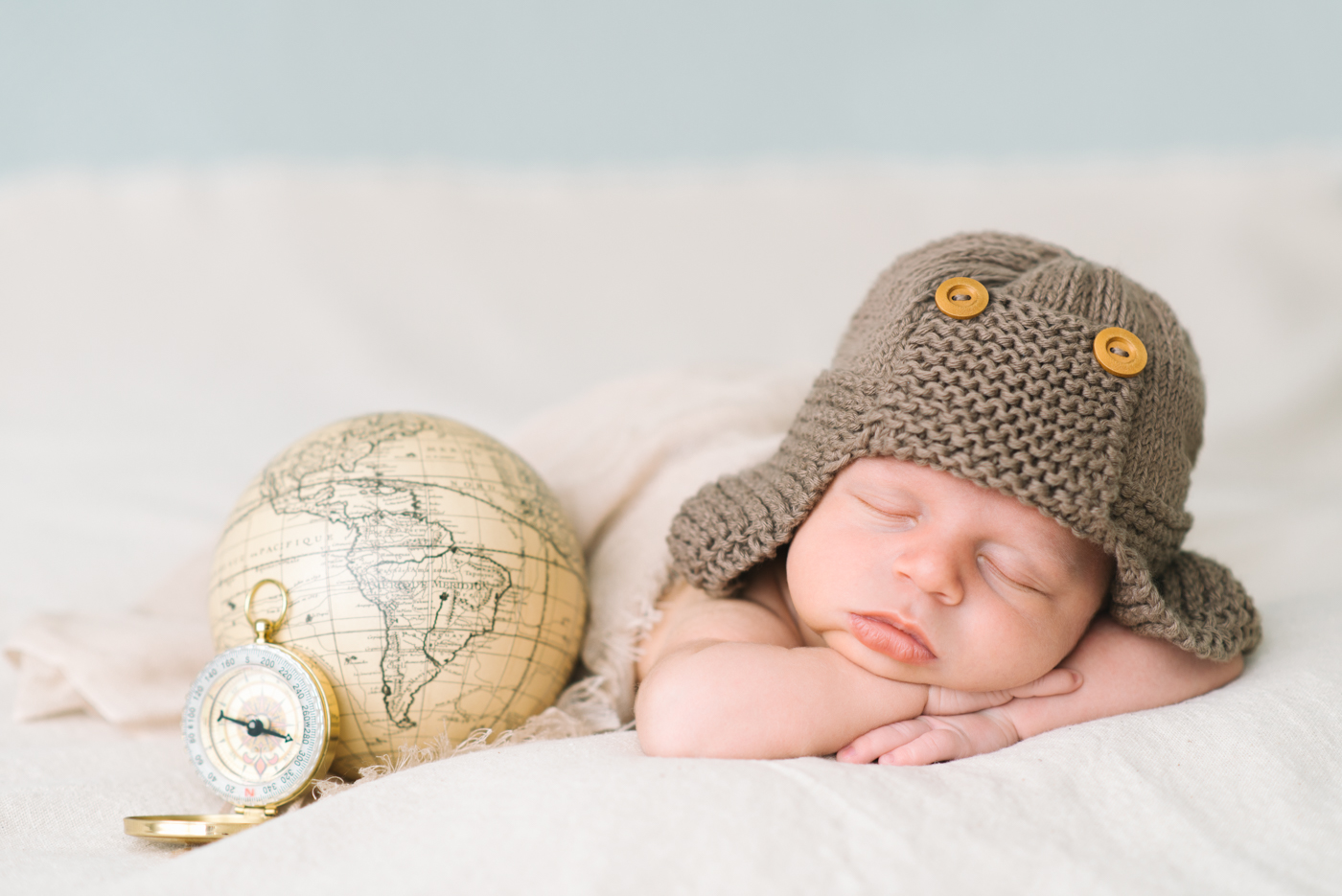 newborn-photographer-portland-oregon-aviator-knit-hat-brown-cream-globe-compass-sleeping-baby-boy-shelley-marie-photo
