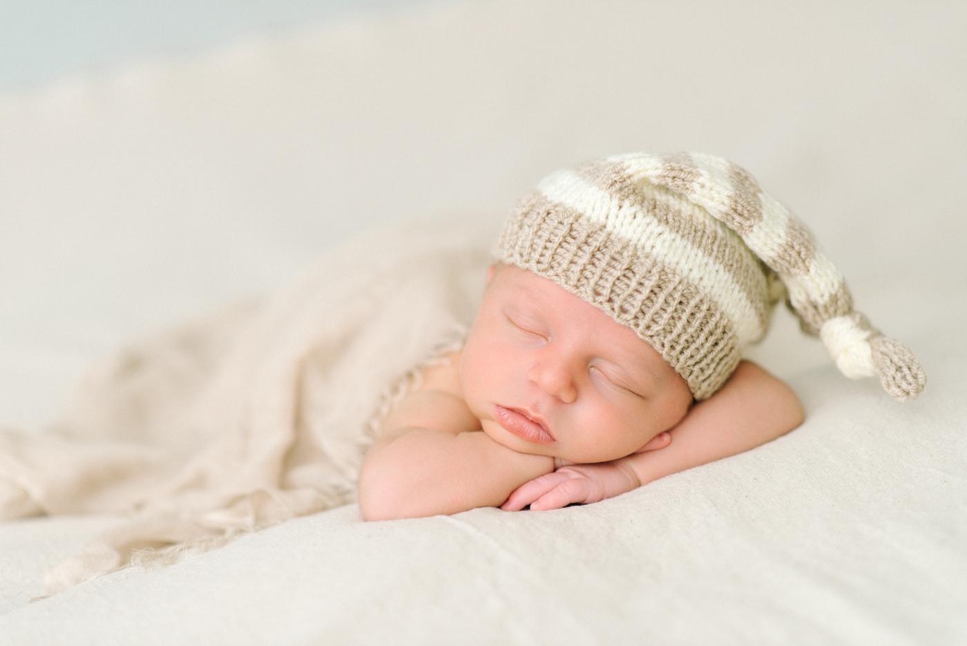 Newborn-Photographer-Portland-Oregon-Portrait-Sleeping-Baby-striped-cream-knit-hat-Natural-light-Shelley-Marie-Photography-3