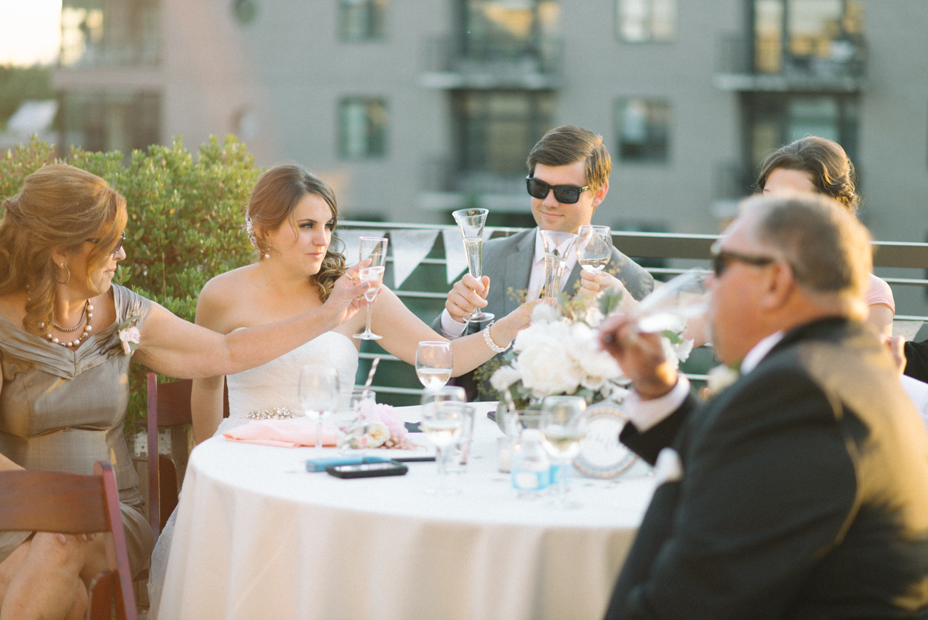 Portland-Oregon-Wedding-photographer-ecotrust-building-terrace-bride-and-groom-portrait-cheers-toast-shelley-marie-photography-3