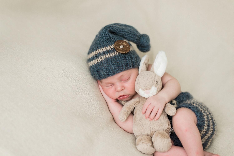 best-portland-oregon-newborn-photographer-sleeping-baby-boy-peter-rabbit-knit-pants-suspenders-shelley-marie-photography-2.jpg