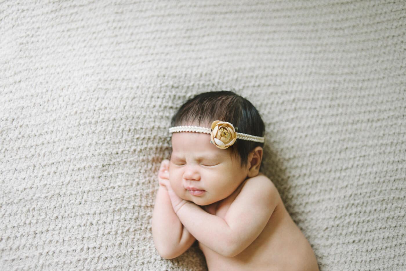best_newborn_photographer_portland_oregon_cream_and_yellow_flower_headband_prayer_holding_hands_shelley_marie_photography_3.jpg
