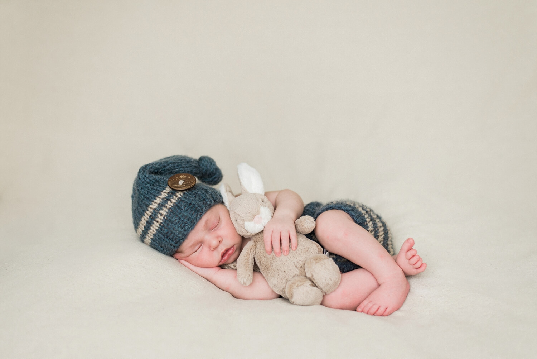 best-portland-oregon-newborn-photographer-sleeping-baby-boy-peter-rabbit-knit-pants-suspenders-shelley-marie-photography.jpg