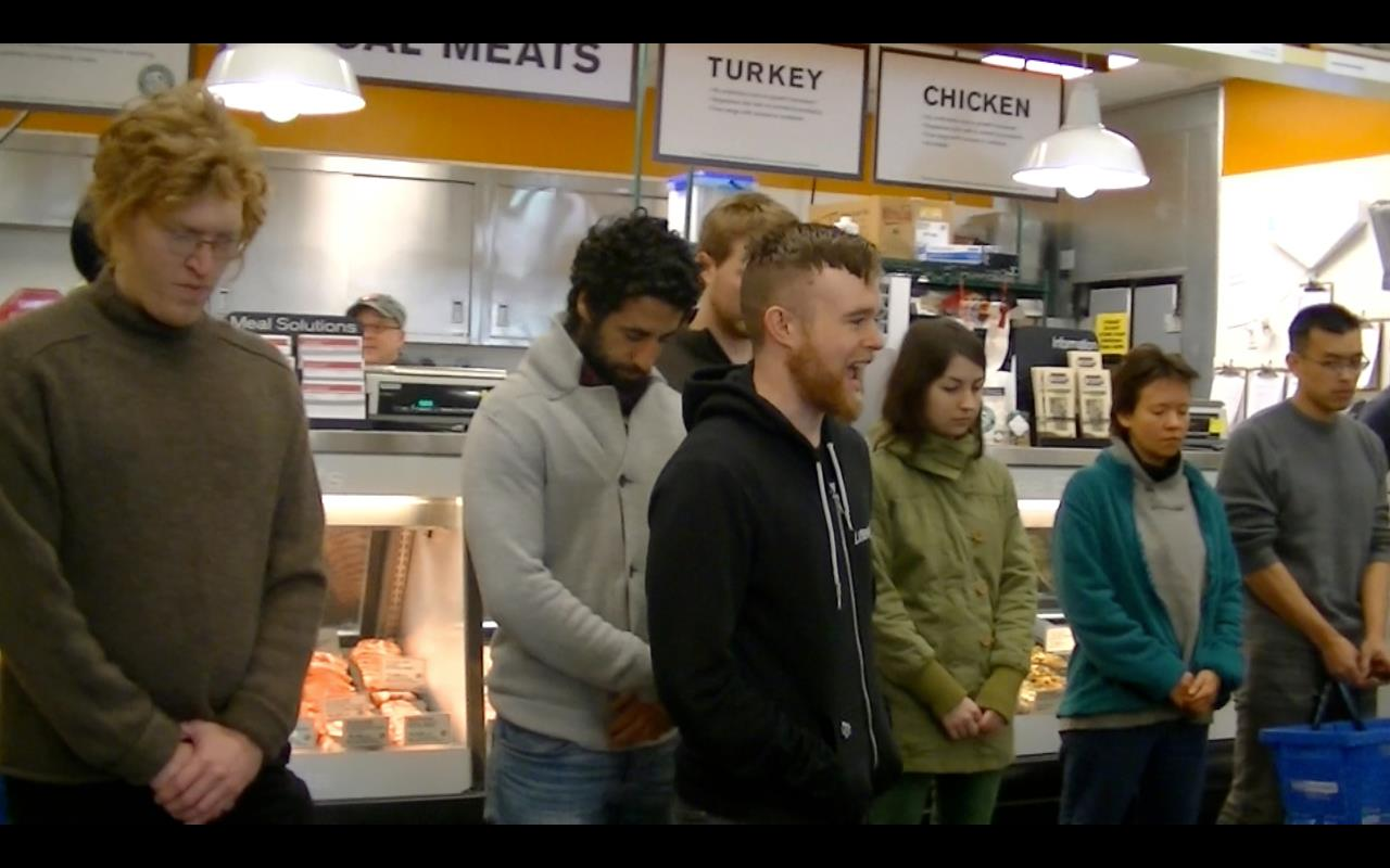 DxE activist Jay, speaking for animals at a Portland meat counter