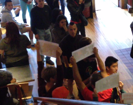 Customers, including Jude, turn and stare, as activists reveal themselves with the message: Someone, Not Something.